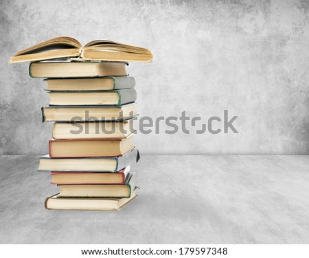 Books on old wall background. High quality.
