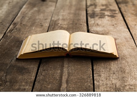 Books on old wooden background