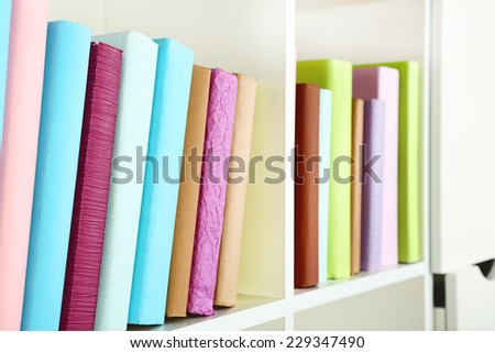 Books on shelf, close-up - stock photo