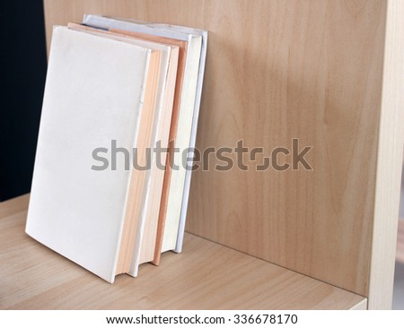 Books on shelves  - stock photo