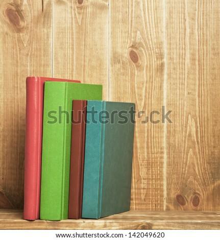 Books on the brown wooden bookshelf - stock photo