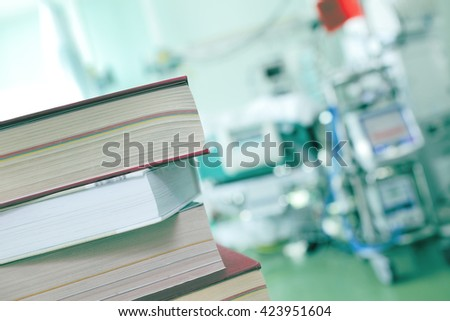 Books on the hospital background. - stock photo
