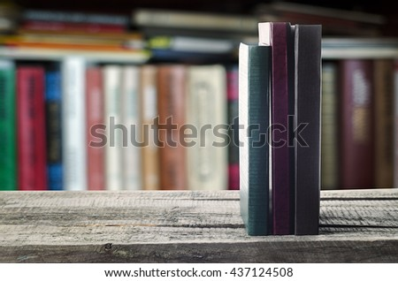 Books on the shelf, invitation to study literatures, close up, reading room