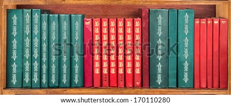 books on the shelf - red and green - wallpaper  - stock photo