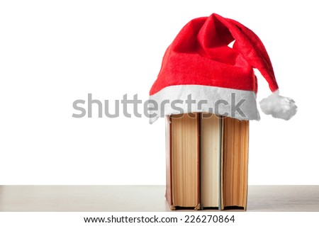 Books on the table in a Christmas style - stock photo