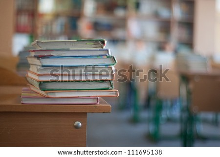 books on the table in the school - stock photo