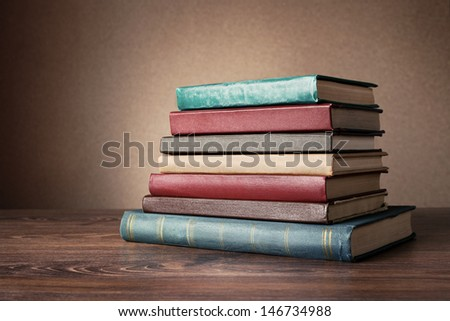 Books on the table. No labels, blank spine. - stock photo