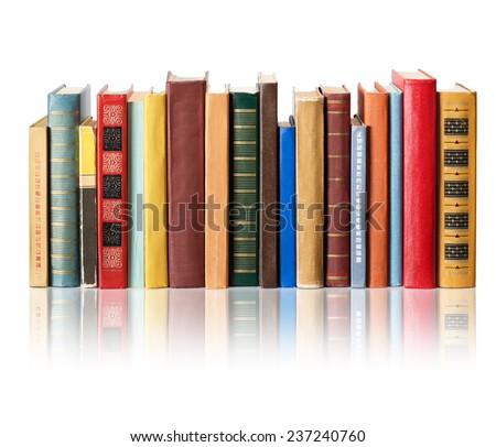 Books on white background with reflection