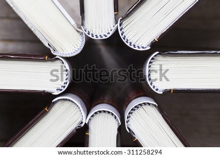 books on wooden planks background, top view - stock photo
