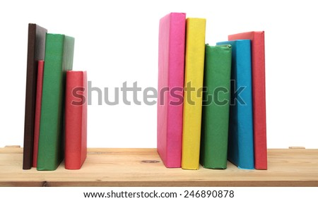 Books on wooden shelf close-up isolated on white background. No labels, blank spine.  - stock photo