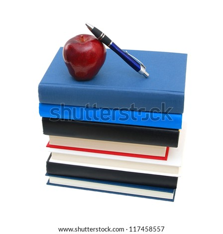 Books , pen tower with apple isolated on white