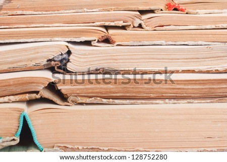 books pile on white. Disclosed old books closeup. background - stock photo