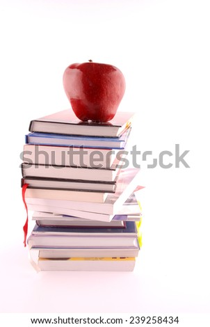 Books pile with red apple on white background, concept back to school - stock photo