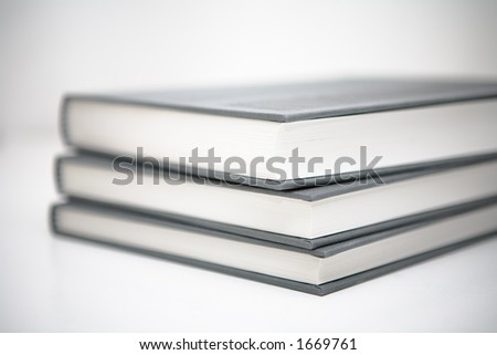 Books piled in abstract environment