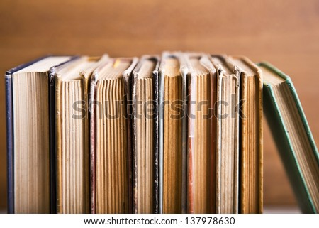 Books placed neatly on a table - stock photo