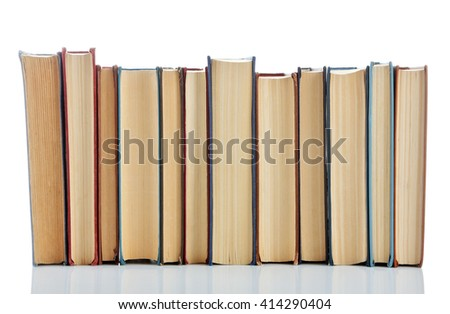 Books positioned in a line isolated on white - stock photo