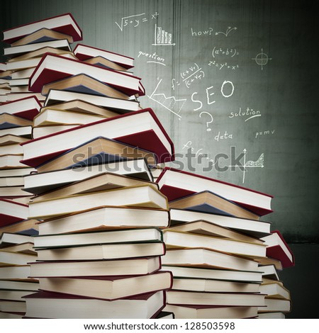 books stacked with formulas fund, education - stock photo
