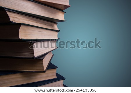 Books stacking. Back to school. Blue background. - stock photo