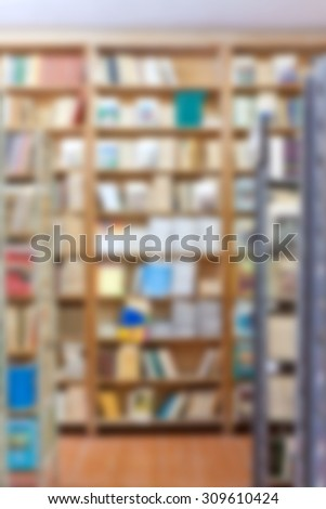 books stand on iron shelves in the library - stock photo
