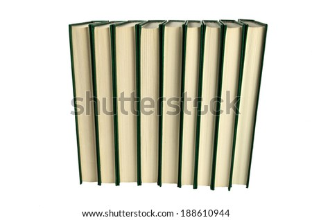 Books standing in a row at white background - stock photo