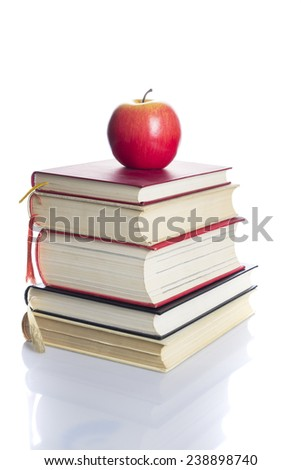 Books tower with red apple isolated on white background - stock photo