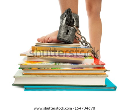 Books under lock and key - stock photo