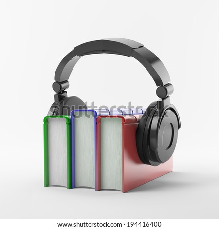 Books with a headphone set - audiobook concept - stock photo