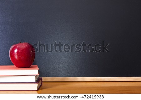 books with apple and pen on the desk