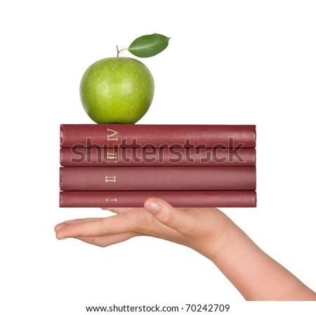 Books with apple in hand as a gift of education - stock photo
