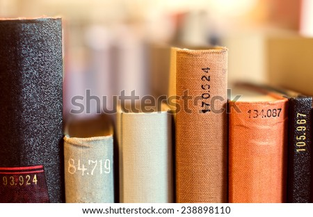 Books with call numbers is the library - stock photo