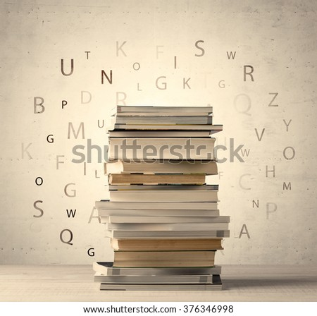 Books with flying letters on vintage old background - stock photo