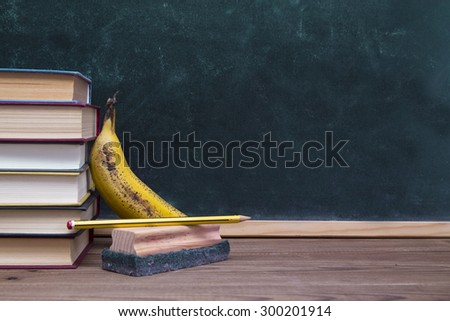books with fruit and slate background - stock photo