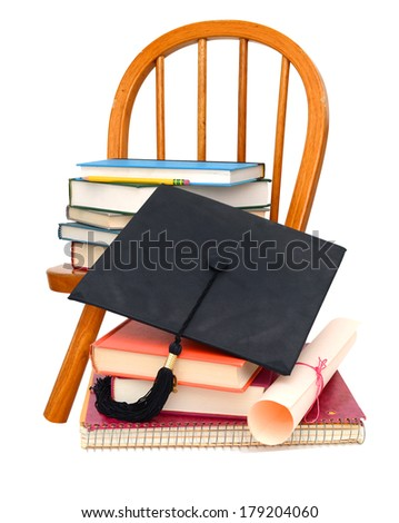 Books with Graduation Cap and Degree, with student chair  - stock photo