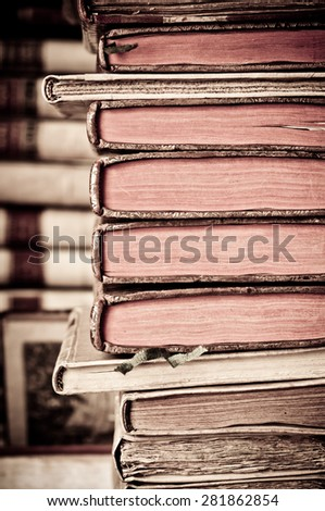 Books with leather covers in a row. Old manuscripts. Aged, used books. - stock photo