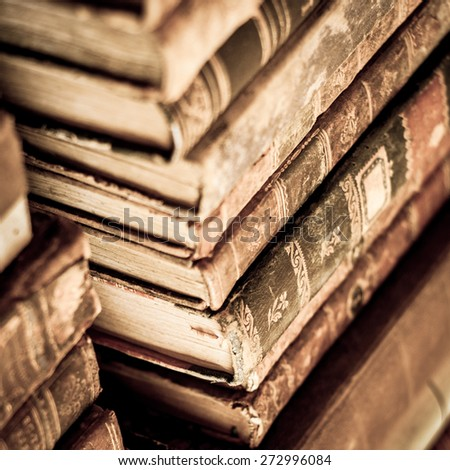 Books with leather covers, stacked.. Old manuscripts. Aged, used books. - stock photo