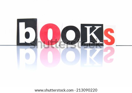 Books with newspaper letters - stock photo