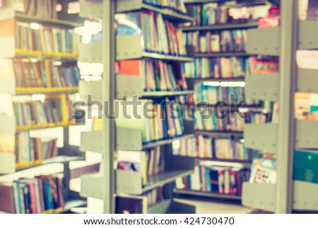 Bookshelf in library with many books,Blurred background.