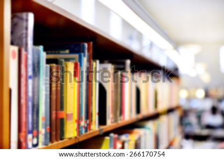 Bookshelf, interior blurred. Intentionally blurred/obscurred  to be used as background - stock photo