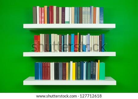 bookshelf on the wall - stock photo