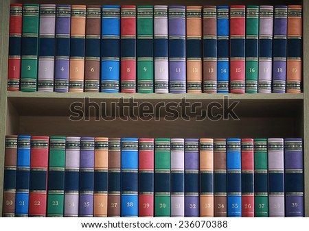 bookshelf with books neatly standing with colored covers - stock photo