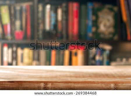 Bookshelf with empty space - stock photo