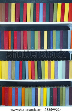Bookshelves with colored books. The collection of books of world literature - stock photo