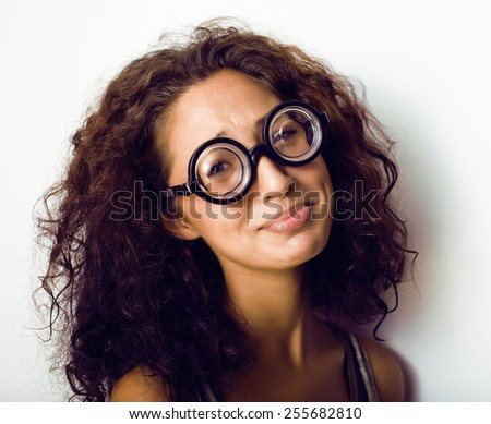 bookworm, cute young woman in glasses, curly hair, teenage - stock photo
