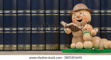 bookworm in front of a row of books - stock photo