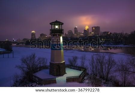 Boom Island Lighthouse and Minneapolis Skyline - stock photo