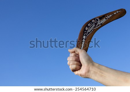 Boomerang - Back Soon - A boomerang is a throwing tool, constructed as a flat airfoil, that is designed to spin about an axis perpendicular to the direction of its flight and to return to the thrower - stock photo