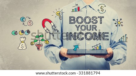 Boost Your Income concept with young man holding a tablet computer  - stock photo