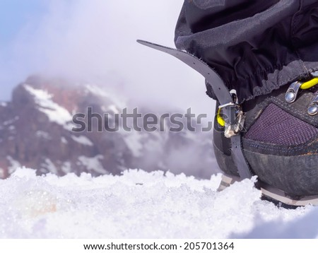 Boot of climber sportsmen hiking to the mountain peak