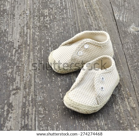 booties for baby on the old wood background - stock photo