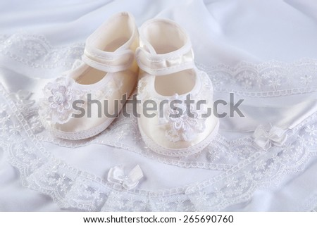 Booties on cloth background - stock photo